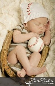 baby boy in a baseball glove