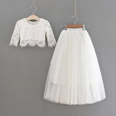 This stunning party outfit features a beautiful white lace crop top with faux pearl button back and mid-length tulle skirt in a gorgeous white hue. This dress is so perfect for dressing up, parties, easter sunday outfits, family photos and more! White Lace Crop Top, Lace Crop Tops, White Tulle Skirt, Tulle Dress, Recuerdos Primera Comunion Ideas, Sunday Outfits, Girls Dresses, Flower Girl Dresses, Suspender Skirt