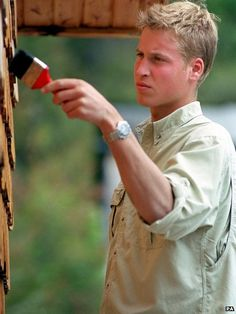 Prince William varnishing the outside of a local radio station in the village of Tortel, Southern Chile during his gap year in 2000
