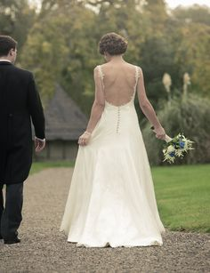 Glenda chose the most delicate of French Chantilly laces in a non corseted fluid silhouette with a scooping low back and long train for her wedding day. #weddingdress #wedding #bespoke #designerweddingdress #bridalgown #luxury #couture #british #britishweddingdressdesigner #londonbride #coutureweddingdress #englishweddingdressdesigner #silk #lace #embroidery #veil