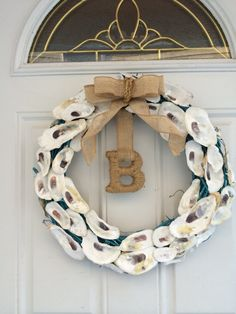 Hey, I found this really awesome Etsy listing at http://www.etsy.com/listing/178186777/oyster-wreath-with-burlap-bow-and