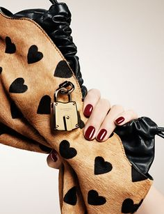 The Little Crush bag in a flirtatious heart print from the A/W13 runway