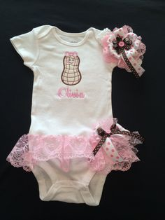Baby Girl's Monogramed Peanut Onesie with Attached Lace Ruffle Skirt. Skirt has a Detachable Matching Bow. Matching Headband. 0-18 Months by PurttyStitches on Etsy https://www.etsy.com/listing/200509349/baby-girls-monogramed-peanut-onesie-with