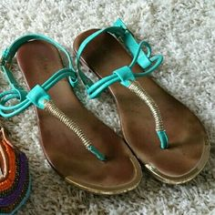 Turquoise Thong Sandals Only Turquoise -Mossimo- Sandals w/ soft leather soles and gold accents. (The dark color in the blue ones is patina'd leather- not dirty) *Tan Sandals have been sold.* Mossimo Supply Co Shoes Sandals