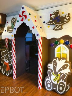 Bringing Our Life-Sized Gingerbread House. To Life Gingerbread Christmas Decor, Candy Land Christmas, Grinch Christmas Decorations, Gingerbread Decorations, Cardboard Gingerbread House, Gingerbread Houses, Christmas Door Decorating Contest, Christmas Classroom Door, School Door Decorations