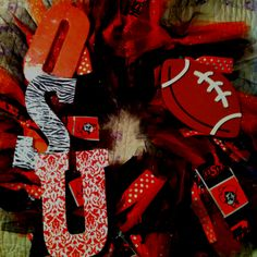 Easy OSU wreath! Foam pipe cover cut in1/2  duct taped together and covered in scraps of tulle fabric and ribbon. Football cut out from hobby lobby and wood letters modge podged with scrapbook paper attach with some hot glue!
