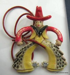 Art Deco Brooch Celluloid Cowboy. Didn't realize the other one I pinned was missing his rope. How cute it this/!