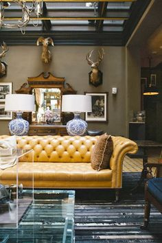 skip the animal heads, but grey/taupe walls and butter yellow leather sofa