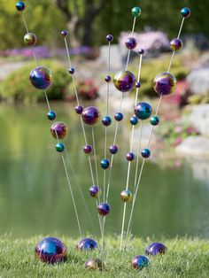 Wind Stalks - DIY: make with ping pong and plastic balls on wire stakes and spray with looking glass paint (Diy Garden Globes) Outdoor Crafts, Outdoor Art, Outdoor Gardens, Garden Crafts, Garden Projects, Looking Glass Paint, Garden Globes, Garden Balls, Vertical Planter