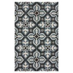 Add a bold pop of style to your patio, sunroom, or foyer with this beautiful indoor/outdoor rug.