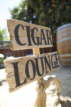 Why not have a cigar corner at your wedding? Stock it with scotch and cigars, and it'll be a hit!