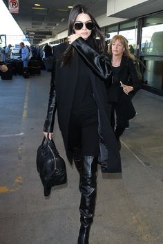 Kendall Jenner wearing  Givenchy Lucrezia Bag, Saint Laurent Classic 11 Aviator Sunglasses, Chanel Calfskin Leather Boots with Metal Cap Toe