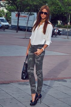 Pair a white button front blouse with charcoal camouflage skinny jeans to effortlessly deal with whatever this day throws at you. Black leather pumps are a great choice to complete the look.   Shop this look on Lookastic: https://lookastic.com/women/looks/button-down-blouse-skinny-jeans-pumps-tote-bag-sunglasses-necklace-bracelet/12737   — Black Embellished Sunglasses  — Gold Necklace  — White Button Down Blouse  — White Bracelet  — Black Leather Tote Bag  — Black Leather Pumps  — Charcoal…
