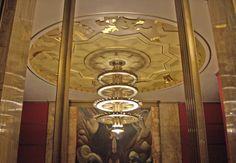 Art deco chandelier in Music Hall at Municipal Auditorium, Kansas City, Missouri.  The hanging bit looks a little like clock gears.