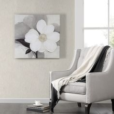 The artist, Ivo, is known for his beautiful floral art. On this beautifully done hand painted embellished canvas, Midnight Bloom's monochrome colors will add a subtle pop needed for your home. Artist: Ivo Stoyanov