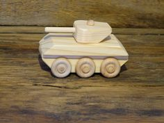 Handmade original design wood toy sherman tank. 4 1/4 inches long and 2 1/4 inches wide, wheels all turn and turret turns 360 degrees. Made from