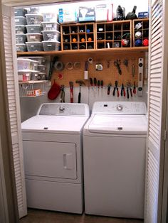 """LAUNDRY Room organization: Top shelf : """"Junk Drawer"""" items The far left-  plastic boxes   middle -  wooden wine bottle boxes."""