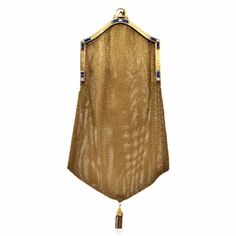 This authentic Victorian gold purse with diamonds and blue sapphires and an integrated mesh gold strap for carrying the purse, is crafted in solid 14K mesh gold, weighs 146.2 grams and measures 8.5″ long and 3 – 5.5″ wide. Designed with a stylized hexagonal format, this refined and delicate evening purse of unique feminine allure and great collectible value features a sturdy yellow gold opening of pyramidal design, enriched on the front side with 16 channel-set square French cut sapphires…