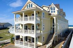 Outer Banks, North Carolina This beachfront property is only $999 a night, which means that even if you bring 20 friends (instead of the 64 that it can hold), you'll still be getting a dirt-cheap price.Total price: $999/nightSleeps: 64= $16/person/night #refinery29 http://www.refinery29.com/large-vacation-rentals-to-rent#slide-41