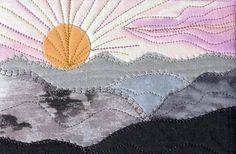 """Mountain Sunset Handmade Fabric Postcard, Quilted Greeting Card, Postcard Art  $12 Details-- *4"""" by 6"""" quilted fabric postcard *Satin stitched on the edge with orchid purple thread. *Can be mailed in the clear mailer provided. *Colors are shades of gray, black, purple and gold. *The back is a light blue fabric that can be written on with a fine line permanent pen. *Created by using layers of fabric and stitching each layer."""