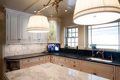 Custom kitchen cabinetry with soapstone countertops.