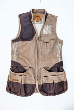 The Clay Break Premium Shooting Vest from Eddie Bauer's new Sport Shop collection protects shoulders with quilted leather patches, while its mesh back keeps shooters cool. Trap Shooting, Shooting Sports, Clay Pigeon Shooting, Sporting Clays, Canvas Jacket, Timberland, Athletic Gear, Hunting Clothes, Better Half