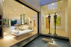 Brilliant Luxurious Home in Modern Interior Design: Small Minimalist Pond Design Located Near Living Room And Hallway In Laurel Home Design . Commercial Interior Design, Interior Design Services, Modern Interior Design, Interior Designing, Pond Design, House Design, Cabana, Led, Living Room Essentials