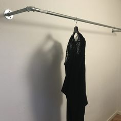 Wall mounted hanging rail of galvanized water pipe steel. industrial raw and simple clothe rack steampunk and urban style