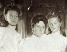 Empress Alexandra with her two oldest daughters, Tatiana and Olga.