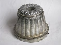 §§§ . Old tin steaming mold make good light fixture over kitchen table in clusters