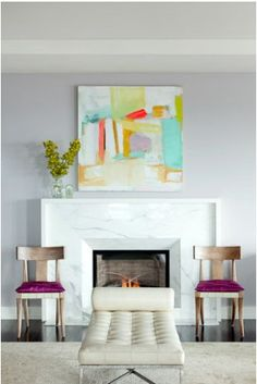 white marble fireplace. Clean Lines, beveled in at the fire box, and, those chairs and chaise.