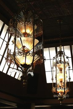 darkhaus:    Art Deco Chandeliers    The beautiful chandeliers of Lake Union Cafe, rescued from the demolition of an even older building, with the copper ceiling in view as well.