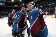 DENVER, CO - MARCH 02: Goaltender Semyon Varlamov #1 of the Colorado Avalanche celebrates a win against the Minnesota Wild with teammate Nathan MacKinnon #29 at the Pepsi Center on March 2, 2018 in Denver, Colorado. The Avalanche defeated the Wild 7-1. (Photo by Michael Martin/NHLI via Getty Images)