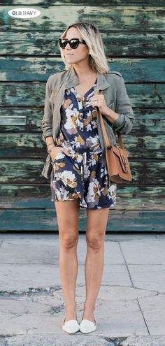 Gorgeous early-fall street style from Damsel in Dior. Get her floral romper, white flats, green field jacket, and crossbody bag online and in store at Old Navy.
