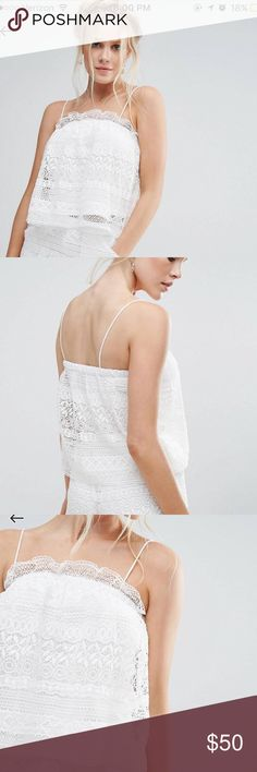 Brand new Asos crochet white cami top Brand new with tags. Purchased from asos but the brand is little white lies. Size xs. Has a lining underneath the crochet and is a cami top. You can tuck in the straps and make it strapless as well. Product info in picture. Asos Tops Blouses