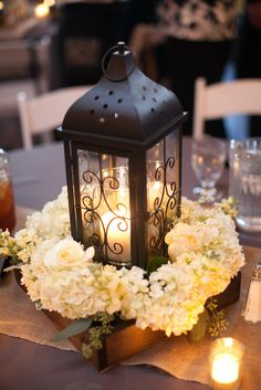 Lantern and white floral centrepiece