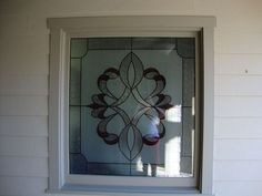 add the look of a stained glass window with faux stained glass fsg by made in the, bathroom ideas, home decor, plumbing, window treatments, windows, Faux stained glass provided ground level privacy for bathroom window while maintaining daylight benefits FSG by Made in the Shade Blinds More