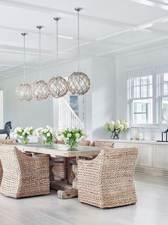 Chic cottage dining room features four Jute Rope Globe Pendants Satin Nickel illuminating a light wood trestle dining table lined with seagrass dining chairs.