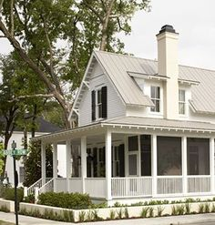 Southern cottage.... I love that porch! Sigh....