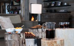 The Lodge, Verbier, Switzerland. Sir Richard Branson's luxury ski chalet in the Alps. Detail shot with bleached timber stools, neutral tones, mulled wine and food.