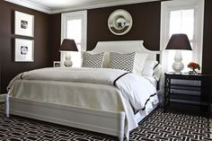 bedrooms - chocolate brown walls paint color white bed white brown fretwork pillows black lattice nightstands white lattice gourd lamps convex mirror white brown graphic rug