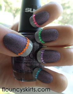 Grey matte shimmer nails with gloss grey tips and coloured rhinestone accents