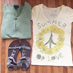 """🌼Summer of Love Woodstock Peace Sign Shirt 🌼 FINAL PRICE DROP🌼 Cute """"Summer of Love"""" Woodstock shirt. Yellow with Daisies in the shape of a peace sign. Size small.   -TShirt Material (I assume cotton) -Fits True to Size -Gold Rhinestones -Light Yellow -V-Neck -Cap Sleeves  🚫 No Trades 🚭 Smoke-Free Home  🚫 Cardigan and shoes not included. Tops Tees - Short Sleeve"""