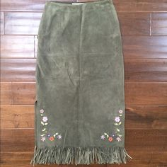 vintage suede midi skirt + embroidery and fringe! A flower child's dream! This 70s bohemian skirt is in great condition for vintage. I picked it up at a consignment store in Paris. There are side slits (as last photo demonstrates) and floral motifs on both front and back of skirt. Zip closure. Lined. Gorgeous green/Aqua color. Skirts Midi
