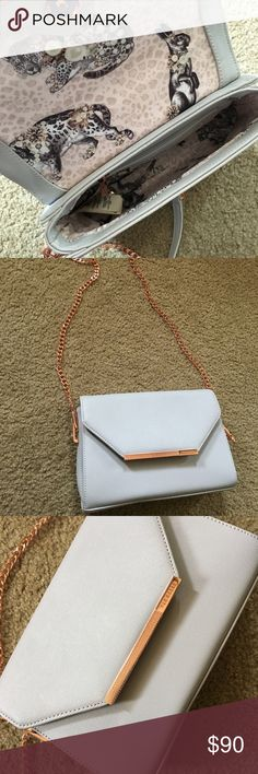 Light Grey purse with rose gold chain Beautiful light grey purse with detailing inside and a rose gold chain perfect for a night out or date night! Ted Baker Bags