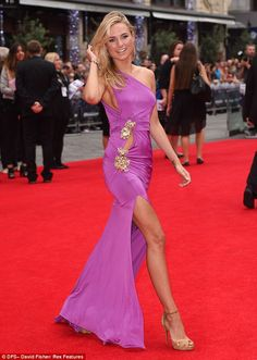 Leggy lady: Kimberley Garner wows in purple cut-out dress as she attends The Expendables 3...