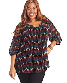 """<p>Go from day to night effortlessly in this fun popover blouse, featuring a multicolored chevron print, semi-sheer chiffon body with pintuck detailing along the center, v-neck with pop trim, 3/4 sleeves, and a round high-low hem.</p>  <p>Model is 5'9"""" and wears a size 1X.</p>  <ul> <li>100% Polyester</li> <li>Machine Wash</li> <li>Imported</li> </ul>"""