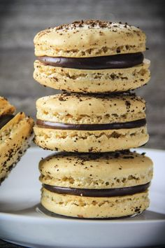 An easy step-by-step guide to get perfect macarons every time. This coffee macaron recipe is full of rich espresso and a smooth chocolate ganache. Gourmet Recipes, Sweet Recipes, Cookie Recipes, Dessert Recipes, Snack Recipes, Coffee Macaroons, Coffee Cookies, Chocolate Espresso, Chocolate Ganache