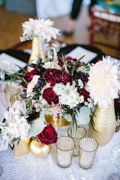 winter wedding centerpiece, photo by Booth Photographics http://ruffledblog.com/the-notwedding-chicago #weddingcenterpieces #reception