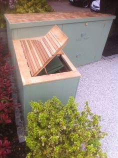 Painted cladding, cedar roof on bike shed and cedar slats on bin store